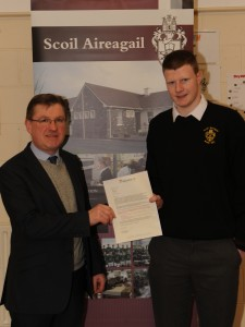 Sean O'Mahony being presented a certificate by Liam O'Brien, principle of Scoil Aireagail for successfully participating in week 15 of the Graduate Online Civic awareness competition, where he has won a 4 day trip to Strasbourg.           Charlie Maher