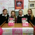 TY girls selling breast cancer ribbons
