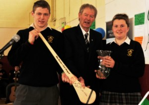 Breda Irish and Andrew Fitzpatrick make a presentation to Miche�l Muircheartaigh